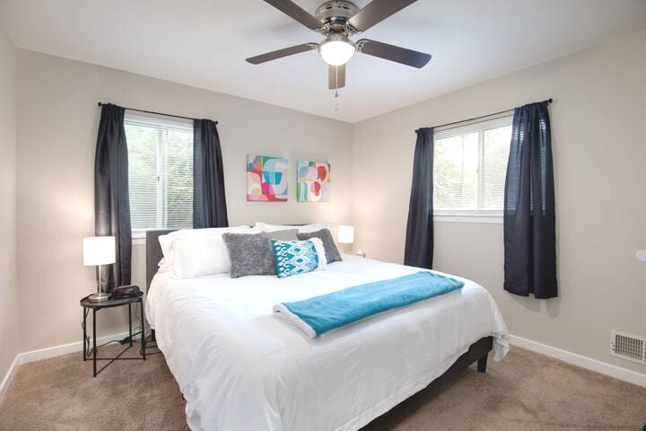 Master bedroom - complete with a comfortable king sized mattress and fresh sheets and pillows!