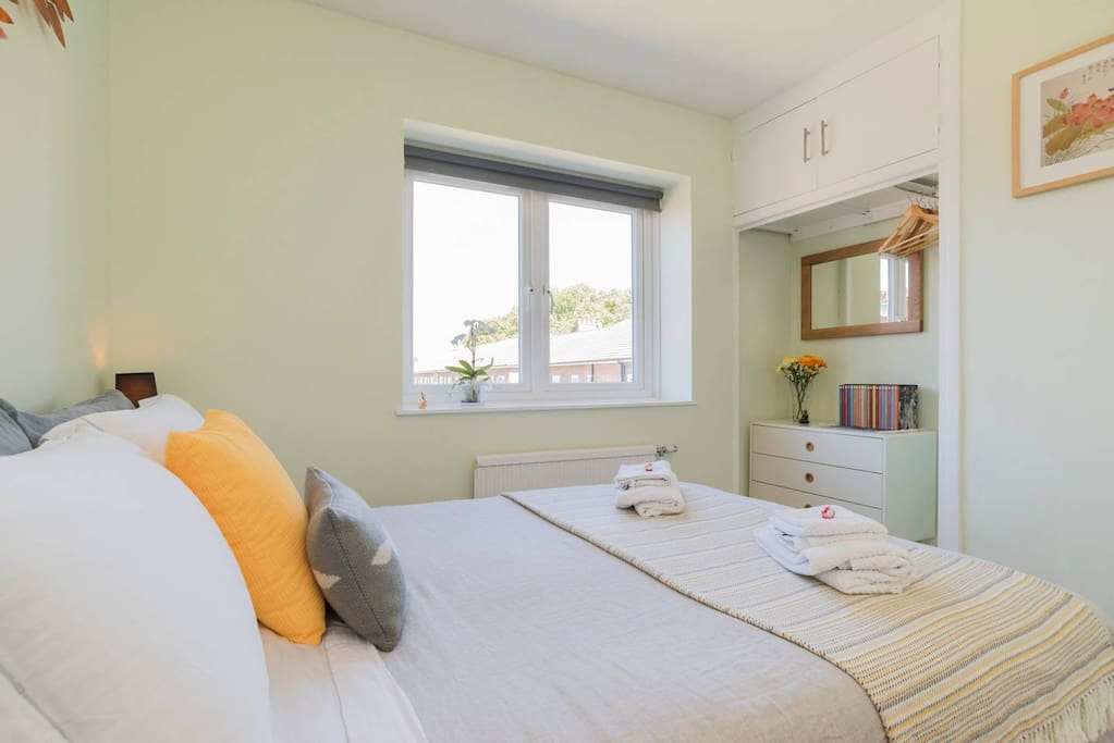 Comfy double bed with Egyptian cotton bed linens and comfy covers.