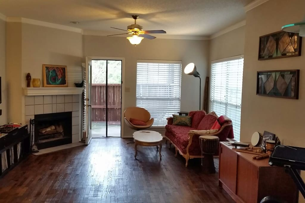 Living room with back door to privately fenced yard.