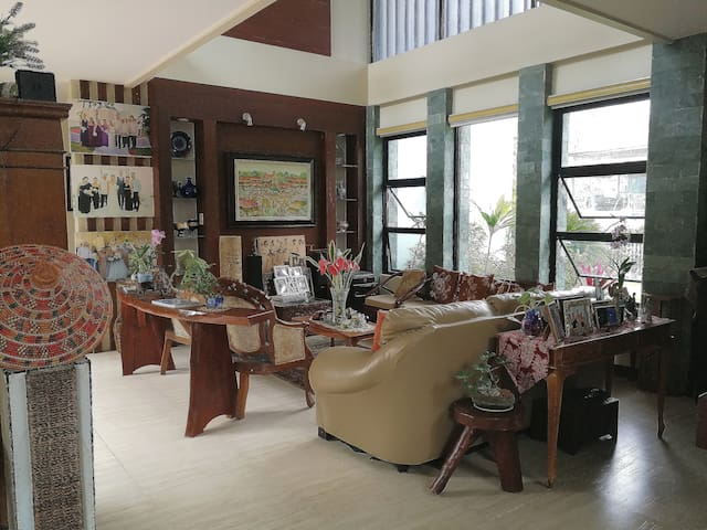 Guests can relax in this open style living room adjacent to the  garden.