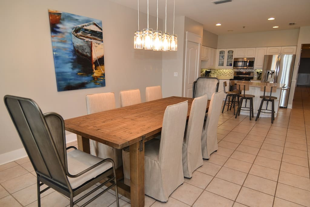 Dining area affords eating space for eight with additional seating for four at the kitchen island
