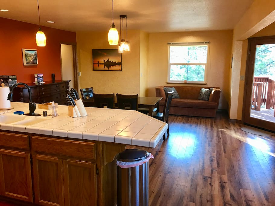 Kitchen / Dining Room area.  All new appliances, counter seating, dining table, and  breakfast bar seat a total of 12.  Additional folding card table, folding long table and padded folding chairs available for more seating.