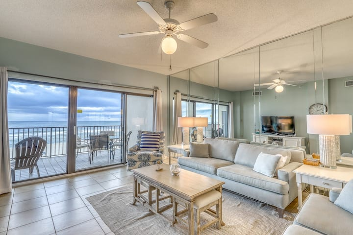 Waterfront condo w/ expansive balcony, grill area, shared pools, and sauna