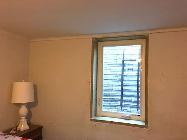 Egress window in the basement bedroom for emergency escape.