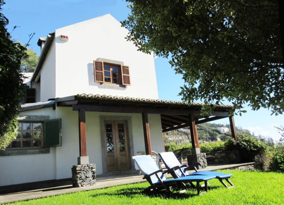 The house has a verandah all around it with sunloungers and a table for eating alfresco