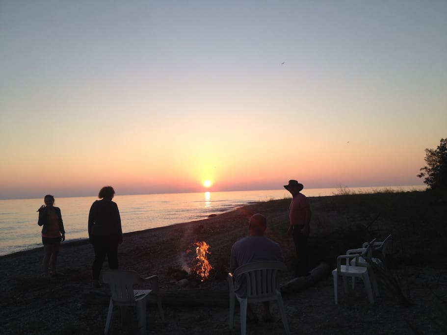 enjoy a fire on the beach while watching the sunset