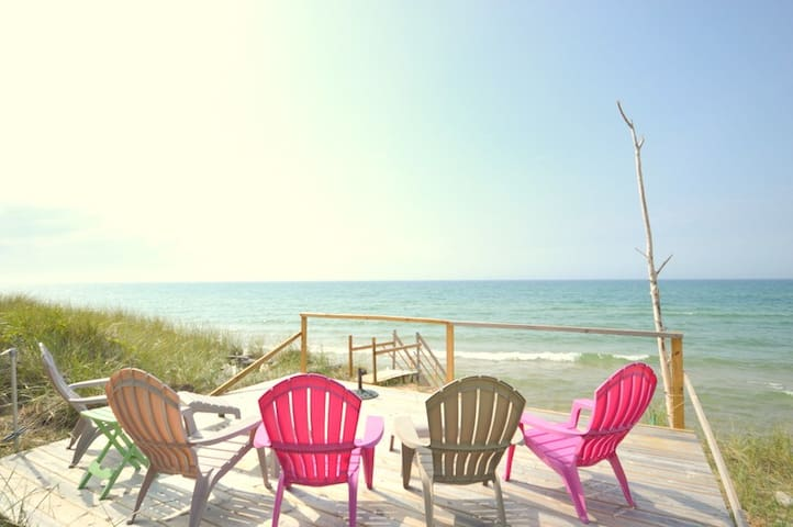 Infinity Cottage is located on Lake Michigan with private beach frontage!