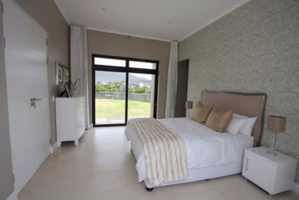 Large master suite with on-suite bathroom & double sliding doors to pool & garden