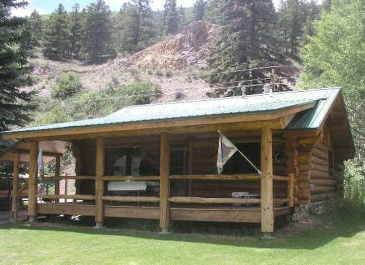 Scandinavian hand-crafted skip-peeled log cabin