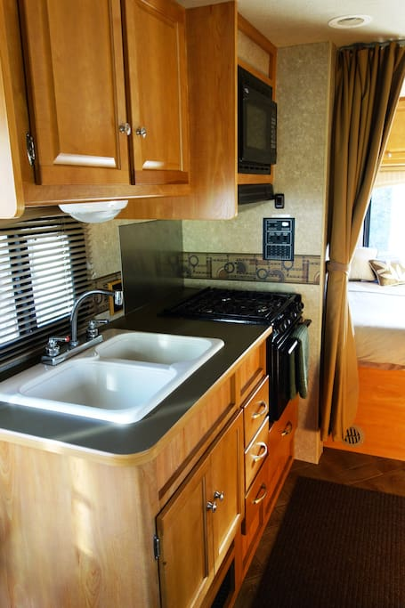 Fully equipped kitchen and rear queen bed