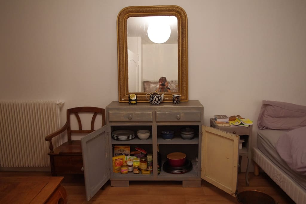 I love old things and I collect them. I  painted the buffet myself.