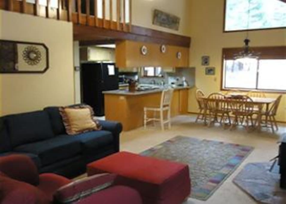 Full Kitchen, Dining area, and spacious great room with wood stove.