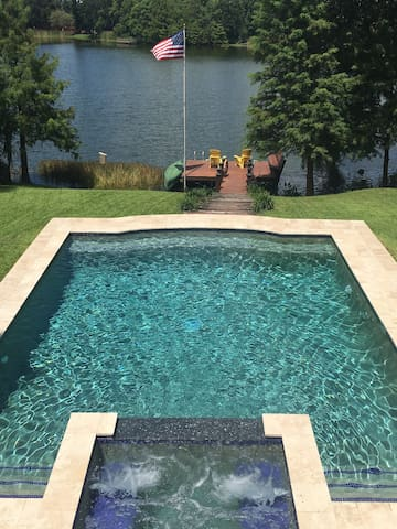 The hot tub overlooks the pool which overlooks the dock and the lake.