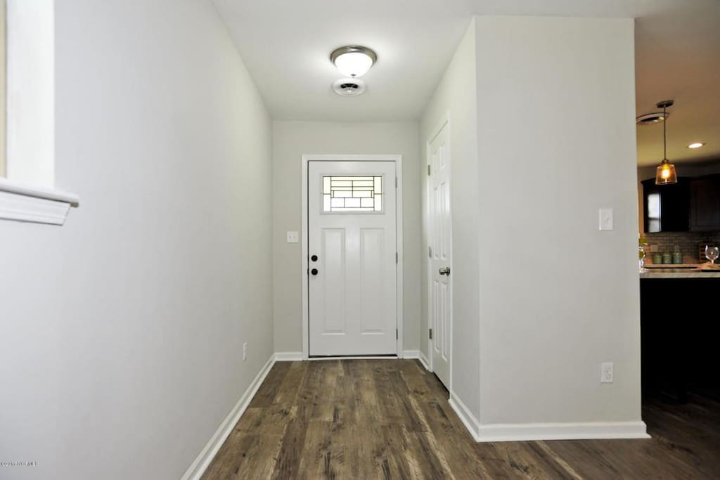 Entry way with closet to store luggage and hang up jackets.  Beautiful hardwood laminate flooring through most of the home.