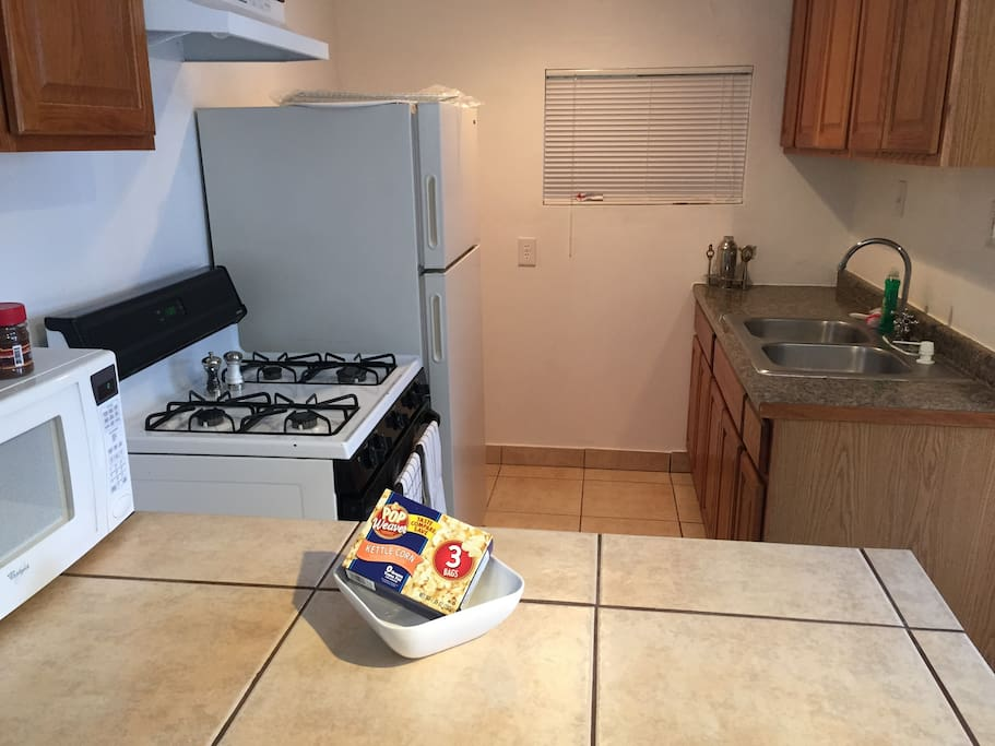 Full kitchen with the basic cooking accessories, utensils etc