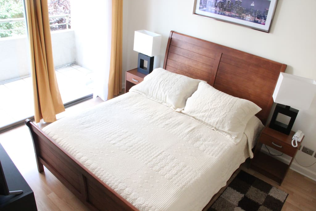 Queen bed and TV with Cable in room
