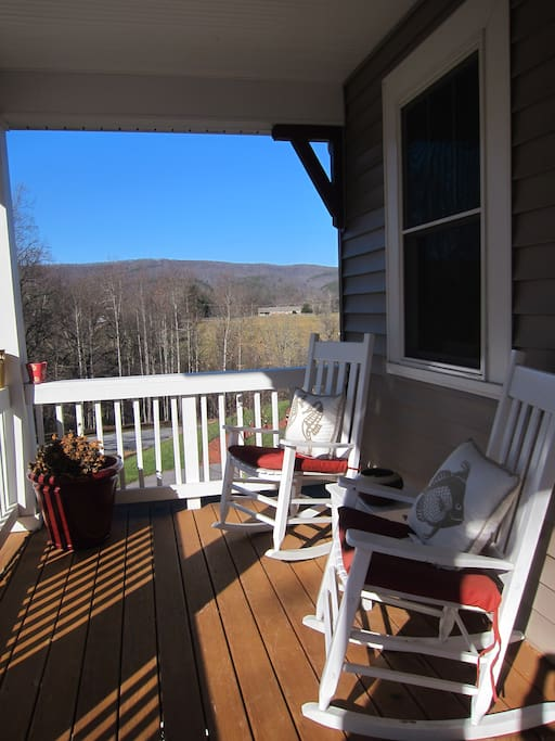 front porch seating area with gorgeous views of the surrounding mountains.