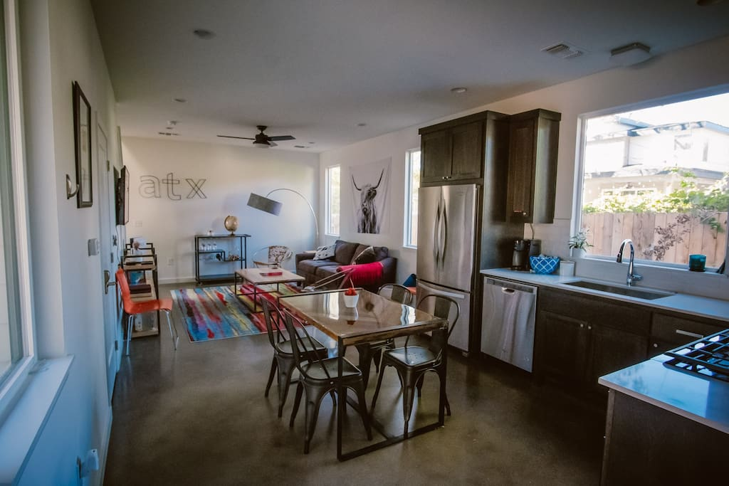 Kitchen with coffee & amenities connected to living room with pull out sofa.