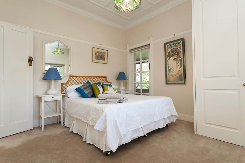 Main bedroom with comfortable queen bed.