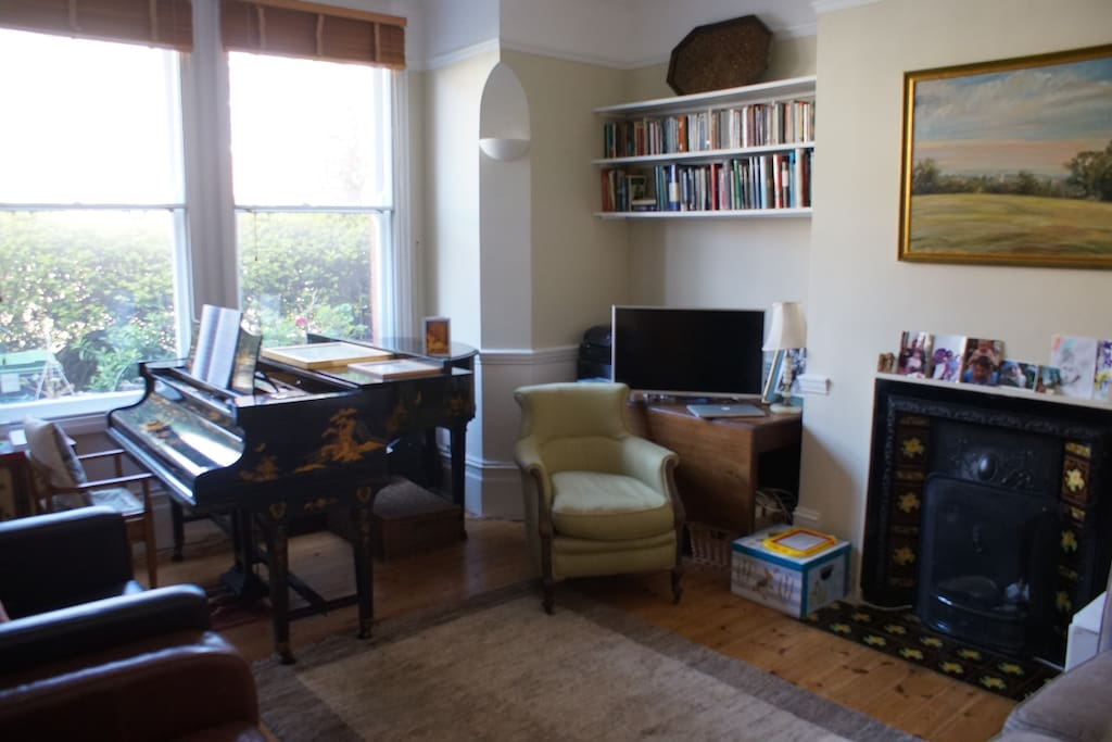 Front living room with piano and television