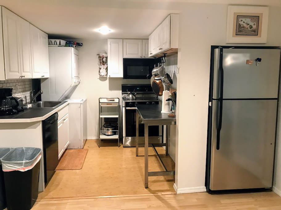 A kitchen with your own washer/dryer.  Small but well equipped kitchen with a full-sized fridge, and stove/oven, microwave, dishwasher, and disposer.