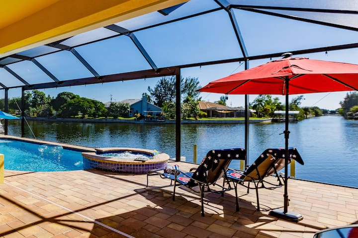 Scenic water view. 2 master suites with direct pool access. Villa Casa Amarilla