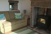 Cosy room with wood burner. Complimentary basket of wood and kindling supplied.