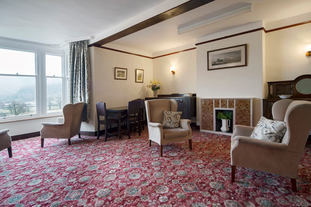 The very large sitting room was converted from a barn in the Victorian times. IT has a wonderful bay window where you can sit and enjoy the view, plenty of seating for up to 8 guests in armchairs and a sofa, and period sideboards and table.