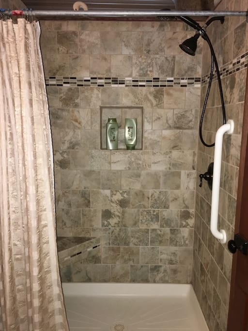 """The """"NEW"""" stand in tiled shower with 2 shower heads."""