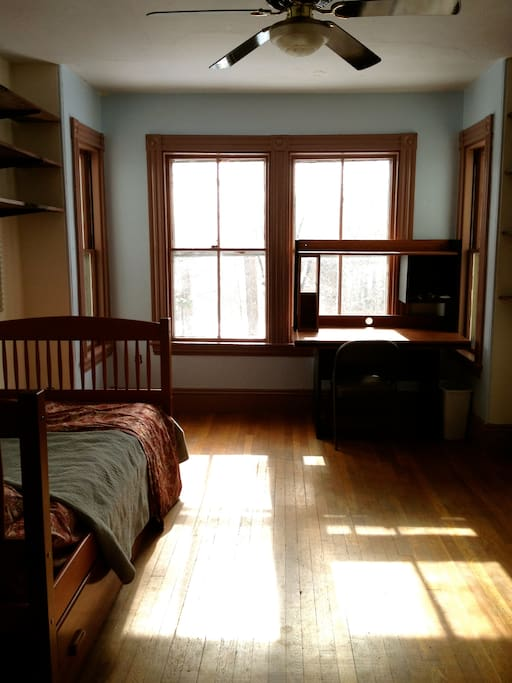 Hardwood floors, bay windows in an old victorian, newly painted.