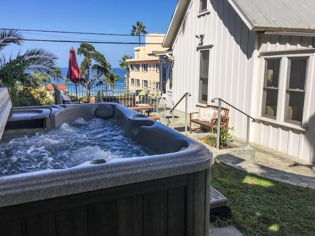 Hot tub in garden with ocean views!
