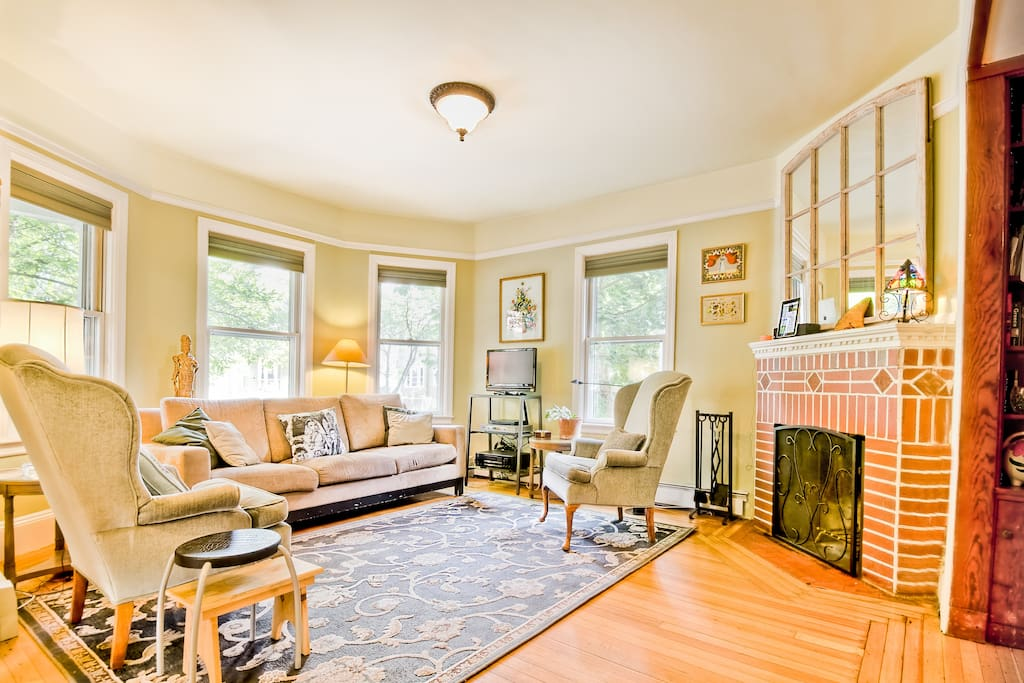 Sunny Bay Windows and a cozy fireplace.