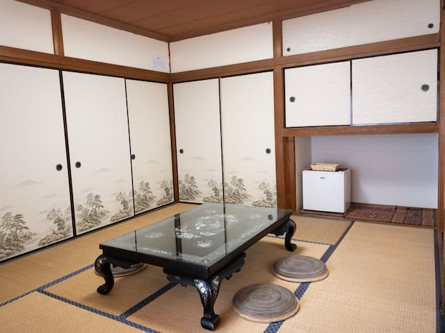 Japanese Tatami room with small refrigerator. Two sets Futon is also here.
