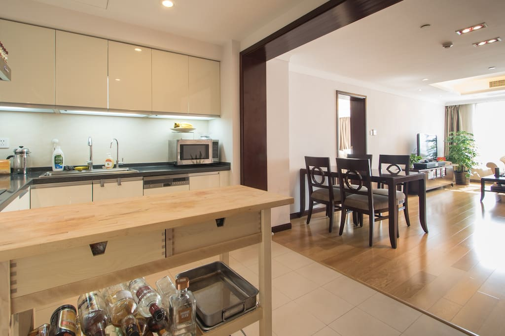 Enter the apartment and be greeted by a full kitchen, hardwood floors and a large living area.