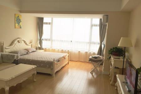 『万达公馆』阳光沙滩家庭度假公寓 - Qingdao - Appartement