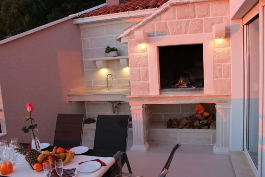 Outdoor fireplace at night...