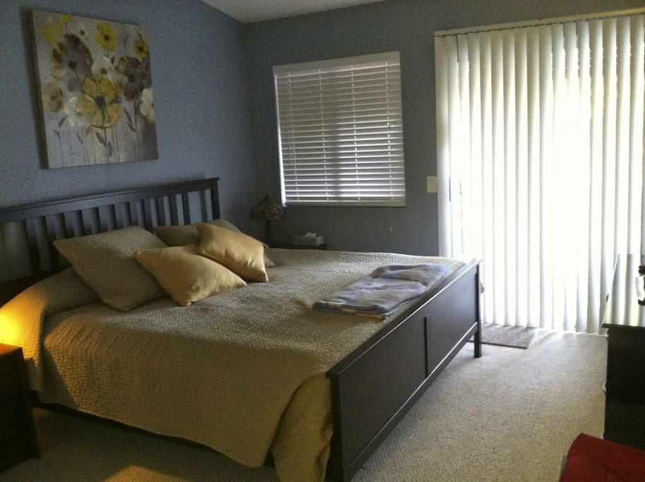 Comfortable King Size bed with crisp, high quality bedding in a quiet, vaulted ceiling master bed/bath room.