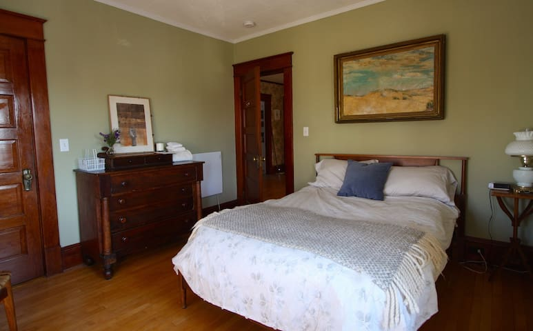 Sunny room with queen bed