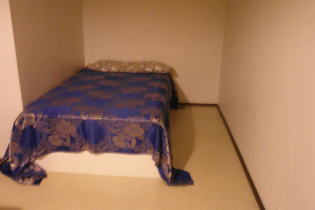 The bed in bedroom area