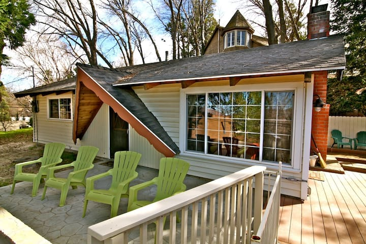 Front of Emerald Bay Lake House with adirondack chairs to enjoy the view of the lake