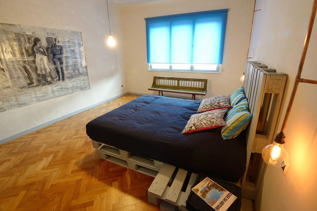 Bedroom, with a large double bed made of pallets; the mattress is very comfortable :)