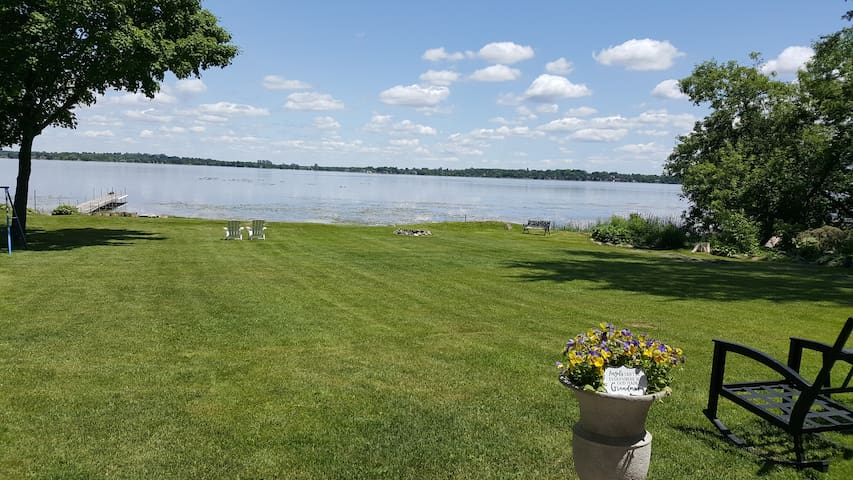 Lakefront 1/2 acre property very private  and Fire pit near water.