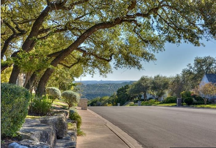 Views of downtown and Hill Country from curb