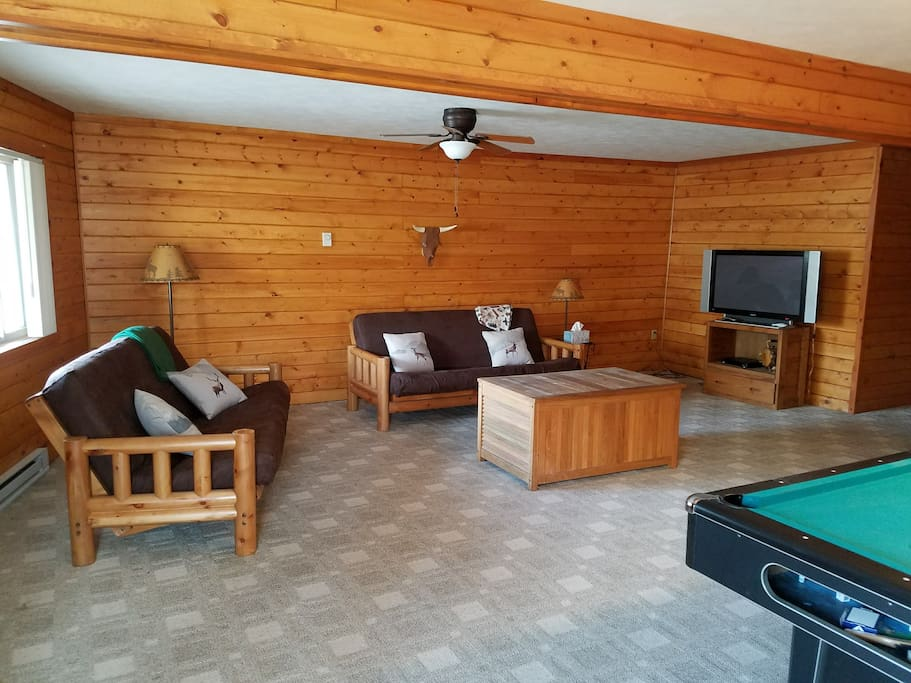 Downstairs den with pool table, 2 futons, and cable TV