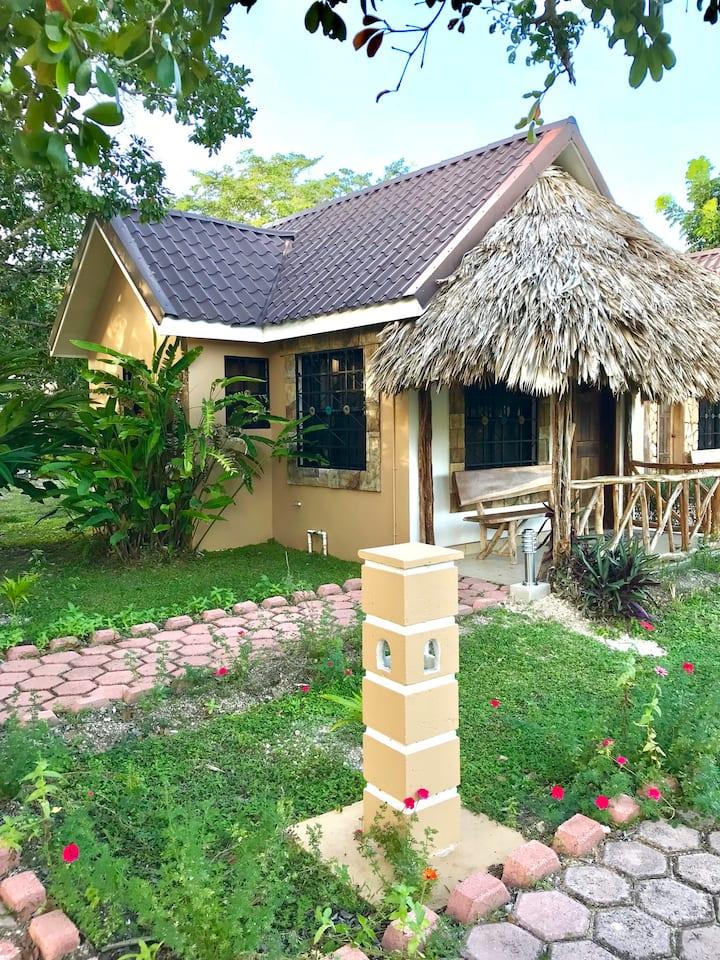 Standard riverside cabin with 1 queen bed