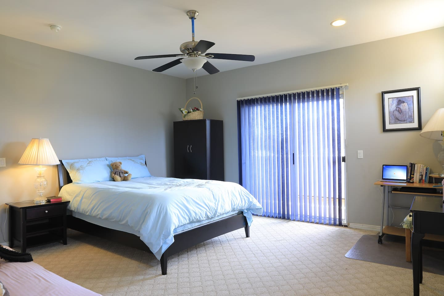 Layout of the room with a queen size bed. The sliding door opens to the covered patio