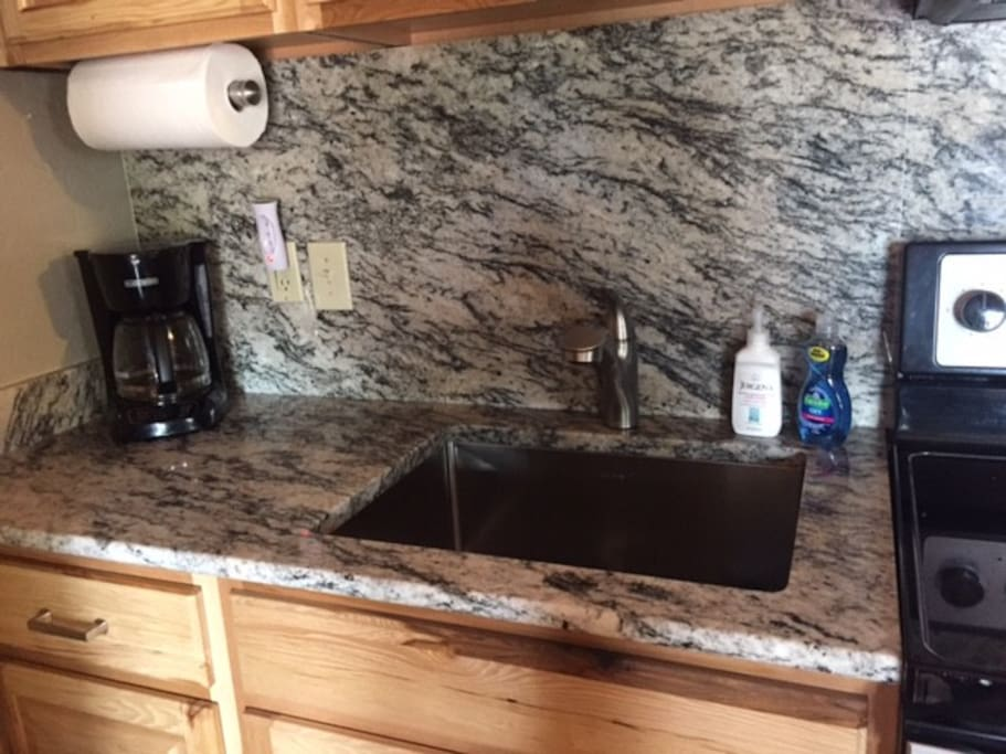 Brand new kitchen with beautiful granite countertop and island.