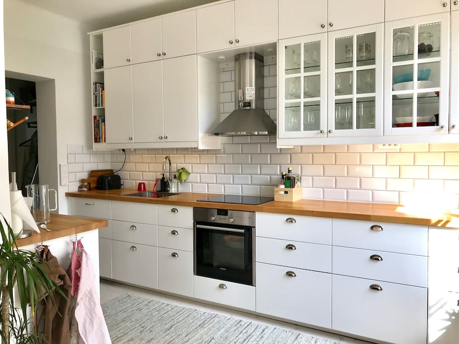 Spacious kitchen with dishwasher and all other supplies you might need for cooking.