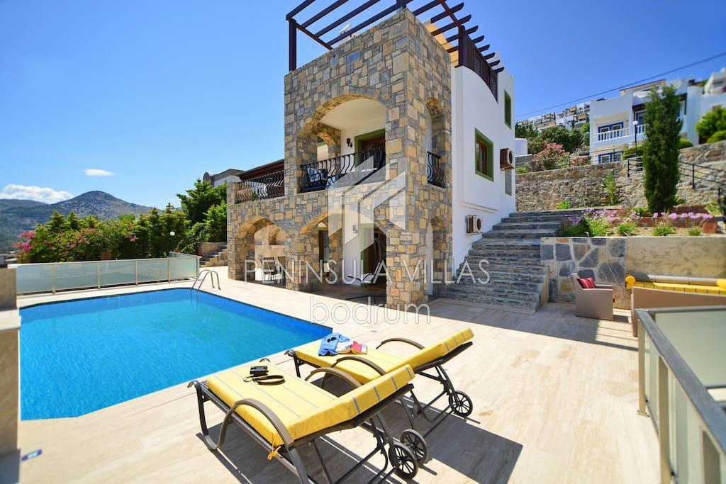 Aegean 220 showing pool, sun deck and villa