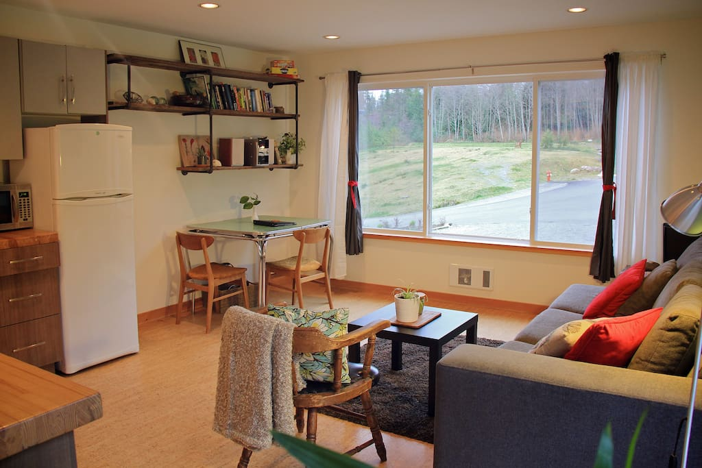 Large, bright windows overlooking the greenspace.